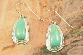 Genuine Manassa Turquoise set in Sterling Silver French Wire Earrings. This Turquoise is also referred to as King�s Manassa Turquoise. The Manassa Turquoise mine is located in Manassa, Conejos County, Colorado. Created by Navajo Artist Sampson Jake. Signed by the artist.