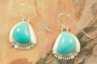 Genuine Manassa Turquoise set in Sterling Silver French Wire Earrings. This Turquoise is also referred to as King's Manassa Turquoise. The Manassa Turquoise mine is located in Manassa, Conejos County, Colorado. Created by Navajo Artist Phillip Sanchez. Signed by the artist.