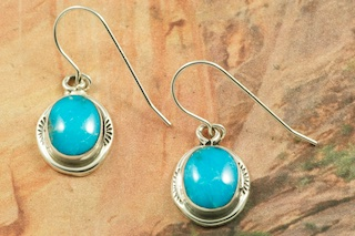 Genuine Sleeping Beauty Turquoise set in Sterling Silver French Wire Earrings. The Sleeping Beauty Turquoise Mine is now closed. The turquoise stones are now obtained from private collections. The Sleeping Beauty Turquoise mine is located in Gila County, Arizona. Created by Navajo Artist Burt Francisco. Signed by the artist.