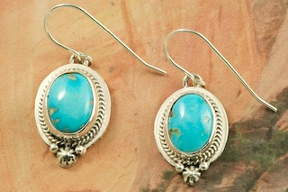 Genuine Sleeping Beauty Turquoise set in Sterling Silver French wire Earrings. The Sleeping Beauty Turquoise mine is located in Gila County, Arizona. Created by Navajo Artist Lucy Valencia. Signed L. J. by the artist.