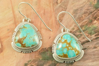 Genuine Number 8 Mine Turquoise Stones set in Sterling Silver French Wire Earrings. The Number 8 mine is located in Eureka County Nevada. Since 1976 there has been no Number 8 Turquoise mined. There is however, an existing stock pile that Mr. Dowell Ward, the last owner of the Number 8 mine, had stocked away for later sorting. The Turquoise is a collector's item--because once the reserve is gone there will be no more material released onto the market. The Gold Mining Company owns the claim to the Number 8 mine and it has been swallowed up by the gold mining operations. This is some of the last Number 8 Turquoise to be had and will be a great addition to your collection. Created by Navajo Artist Kathy Yazzie. Signed by the artist.