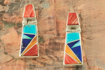 Genuine Turquoise, Spiny Oyster Shell and Blue Lapis inlaid between Sterling Silver. Beautiful Fire and Ice Lab Opal Accents. Post Earrings Designed by Navajo Artist Calvin Begay. Signed by the artist.