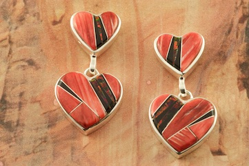 Stunning Double Heart Design featuring Genuine Fire Spiny Oyster Shell, Acoma Jet and Fire & Ice Lab Opal Accents inlaid between ribbons of Sterling Silver. Post Earrings Designed by Navajo Artist Calvin Begay. Signed by the artist.