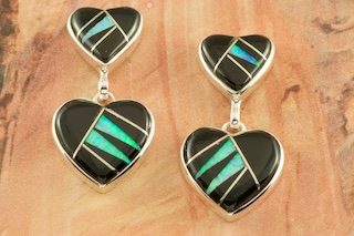 Stunning Double Heart Design featuring Genuine Acoma Jet and Fire & Ice Lab Opal Accents inlaid between ribbons of Sterling Silver. Post Earrings Designed by Navajo Artist Calvin Begay. Signed by the artist.