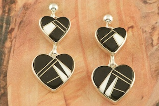 Stunning Double Heart Design featuring Genuine Acoma Jet and White Agate inlaid between ribbons of Sterling Silver. Post Earrings Designed by Navajo Artist Calvin Begay. Signed by the artist.