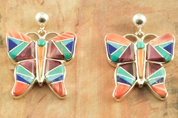 Stunning Butterfly Earrings featuring Genuine Turquoise, Spiny Oyster Shell and Blue Lapis inlaid between ribbons of Sterling Silver. Beautiful Fire and Ice Lab Opal Accents. Post Earrings Designed by Navajo Artist Calvin Begay. Signed by the artist.