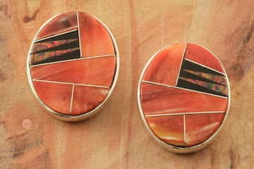 Stunning Earrings featuring Genuine Fire Red Spiny Oyster Shell and Acoma Jet inlaid between ribbons of Sterling Silver. Beautiful Fire Red Lab Opal Accents. Post Earrings Designed by Navajo Artist Calvin Begay. Signed by the artist.