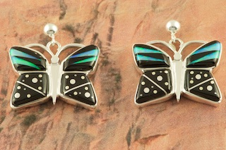 Starry Night Butterfly Design featuring Genuine Acoma Jet inlaid in Sterling Silver. Beautiful Fire and Ice Lab Opal Accents. Post Earrings Designed by Navajo Artist Calvin Begay. Signed by the artist.