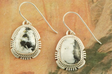 Genuine White Buffalo Turquoise set in Sterling Silver French Wire Earrings. This Beautiful Stone is formed from the minerals Calcite and Iron. It is mined near Tonopah Nevada. Created by Navajo Artist Larson Lee. Signed by the artist.