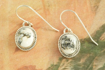 Genuine White Buffalo Turquoise set in Sterling Silver French Wire Earrings. This Beautiful Stone is formed from the minerals Calcite and Iron. It is mined near Tonopah Nevada. Created by Navajo Artist Collier Nelson. Signed by the artist.
