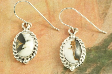 Genuine White Buffalo Turquoise set in Sterling Silver French Wire Earrings. This Beautiful Stone is formed from the minerals Calcite and Iron. It is mined near Tonopah Nevada. Created by Navajo Artist Burt Francisco. Signed by the artist.