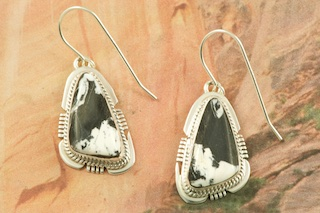 Genuine White Buffalo Turquoise set in Sterling Silver French Wire Earrings. This Beautiful Stone is formed from the minerals Calcite and Iron. It is mined near Tonopah Nevada. Created by Navajo Artist Kathy Yazzie. Signed by the artist.