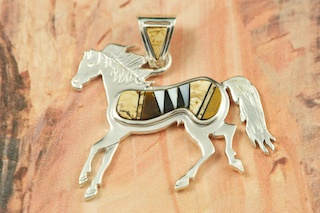 "Genuine Picture Jasper, Tiger's Eye and Mother of Pearl inlaid in Sterling Silver Horse Pendant. Fire and Ice Lab Opal Accents. Beautiful inlay work on the bail and pendant. Free 18"" Sterling Silver Chain with purchase. Designed by Navajo Artist Calvin Begay. Signed."
