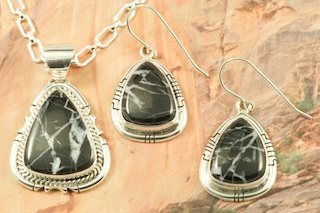 "Stunning Pendant and Earrings Set featuring Genuine White Lightning set in Sterling Silver. Free 18"" Sterling Silver Chain. White Lightning Stones are a stunning new discovery from the hills of Tonopah, Nevada. Created by Navajo Artist Joe Piaso. Signed by the artist."