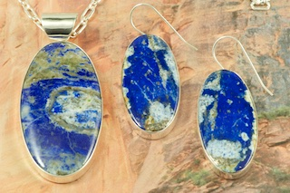 "Mother Nature is amazing. The matrix ( the pattern ) in this stone is all natural. No two stones are alike. Genuine Lapis Diopside set in Sterling Silver. Beautiful Pendant and Earring Set with an 18"" Sterling Silver Chain. Created by Navajo Artist Lyle Piaso. Signed by the artist."