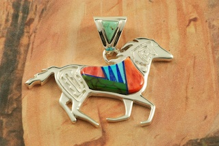 "Beautiful Horse Pendant featuring Genuine Turquoise, Spiny Oyster Shell, and Blue Lapis inlaid in Sterling Silver. Free 18"" Sterling Silver Chain with purchase of pendant. Designed by Navajo Artist Calvin Begay. Signed by the artist."