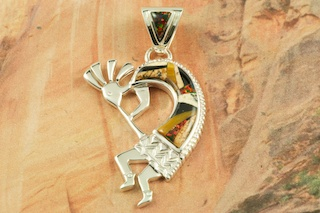 "Beautiful Kokopelli Pendant featuring Genuine Picture Jasper, Tiger's Eye and Black Jade inlaid in Sterling Silver.  Fire and Ice Lab Opal Accents. Precision inlay on the Bale and Pendant. Free 18"" Sterling Silver Chain with purchase. Designed by Navajo Artist Calvin Begay. Signed by the artist."