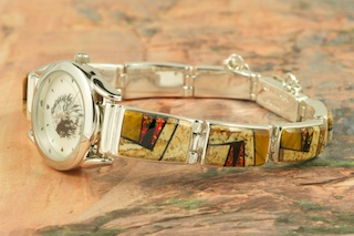Quartz Watch Bracelet featuring Genuine Picture Jasper and Black Jade with accents of Fire and Ice Lab Opals inlaid in Sterling Silver. Created by Navajo Artist Calvin Begay. Signed by the artist.
