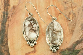 "Stunning Earrings feature Genuine Wild Horse Stones set in Sterling Silver French Wire Earrings. This stone is also known as ""Crazy Horse"". It is mined near Globe, Arizona. Created by Navajo Artist Lucy Valencia. Signed L. J. by the artist."