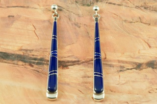 Genuine Blue Lapis inlaid between ribbons of Sterling Silver. Stunning Post Earrings Designed by Navajo Artist Calvin Begay. Signed by the artist.