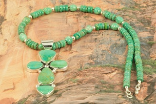 Stunning Pendant and Necklace Set. Genuine Manassa Turquoise set in Sterling Silver Pendant. Necklace features Genuine Manassa Turquoise with Sterling Silver Beads and Clasp. Created by Navajo Artist Evelyn Yazzie. Signed by the artist. This Turquoise is also referred to as King�s Manassa Turquoise. The Manassa Turquoise mine is located in Manassa, Conejos County, Colorado.