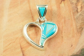 "Beautiful Heart Pendant featuring Genuine Sleeping Beauty Turquoise set in Sterling Silver.  Free 18"" Sterling Silver Chain with Purchase of Pendant. Designed by Navajo Artist Calvin Begay. Signed by the artist."