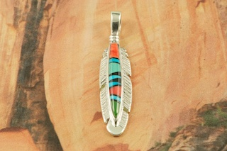 "Genuine Turquoise, Spiny Oyster Shell and Black Jade inlaid in Sterling Silver. Free 18"" Sterling Silver Chain with Purchase of Pendant. Stunning Feather Pendant Designed by Navajo Artist Calvin Begay. Signed by the artist."