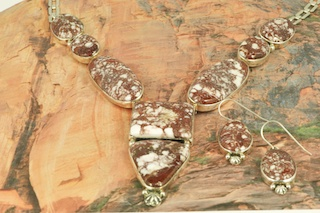 "Stunning Necklace and Earrings Set featuring Genuine Wild Horse set in Sterling Silver. This stone is also known as ""Crazy Horse"". It is mined near Globe, Arizona. Created by Navajo Artist Lucy Valencia. Signed by L. J. the artist. The photo is of the jewelry you will be receiving."