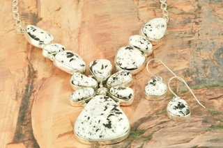 Genuine White Buffalo Turquoise set in Sterling Silver. Stunning Necklace and Earrings Set. Created by Navajo Artist Lucy Valencia. Signed by L. J. the artist. The photo is of the jewelry you will be receiving. This Beautiful Stone is formed from the minerals Calcite and Iron. It is mined near Tonopah Nevada.