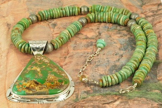 "Stunning Pendant and Necklace Set featuring Genuine Royston Turquoise set in Sterling Silver Pendant. 18"" Genuine Turquoise Necklace with Sterling Silver Beads and Clasp. Created by Navajo Artist Phillip Sanchez. Signed by the artist. Royston Turquoise Mine was originally known as the Royal Blue Mine. It produces Turquoise that has a mixture of blues and greens in the same formation. The Royston Turquoise Mine is located in Nye County, Nevada."