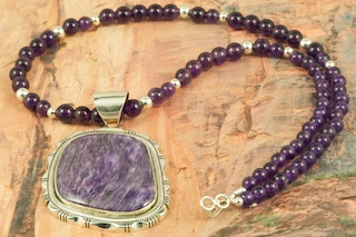 Genuine Charoite set in Sterling Silver Pendant on a Genuine Amethyst Necklace with Sterling Silver Beads and Clasp. Created by Navajo Artist Walter Vandever. Signed by the artist. Charoite is a Beautiful and interesting gemstone first introduced in the US around 1976. It's vivid colors range from lavender to deep chatoyant purple. It is mined in Siberia Russia near Charo River, Lake Baikal region. High grade charoite is distinguished by mixtures of deep rich purple and silky zones, in swirly and/or needle-like chatoyant patterns/sprays.