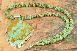 Stunning Pendant and Necklace Set featuring Genuine Crow Springs Turquoise set in Sterling Silver Pendant. Necklace features Genuine Turquoise with Sterling Silver Beads and Clasp. Created by Navajo Artist Phillip Sanchez. Signed by the artist. The Crow Springs Mine is located near Tonopah, Nevada. The Crow Springs Turquoise Mine was closed for many years. It recently was opened by Dennis and Lucy Cordova. The Smith family previously owned the mine. This family had been mining turquoise in Nevada since the 1870�s. In 1909, William Petry discovered a deposit one mile southwest of the Crow Springs claim. In 1939, Ann Cooper Hewitt, heiress to the Cooper Hewitt fortune, made from inventing the mercury-vapor lamp and the first fluorescent lighting, filed claim to the mine and built a home there, which she called AnnJax. She did little work on the property and subsequently abandoned it.