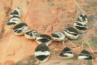 Stunning Necklace and Earrings Set featuring Genuine White Lightning set in Sterling Silver. Created by Navajo Artist Lyle Piaso. Signed by the artist. White Lightning Stones are a stunning new discovery from the hills of Tonopah, Nevada.
