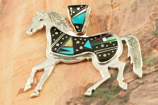 "Amazing Night Sky Horse Pendant by the Famous Navajo Artist Calvin Begay. Genuine Black Jade accented with Sleeping Beauty Turquoise inlaid in Sterling Silver. Stunning Fire and Ice Lab Opal accents. Free 18"" Sterling Silver Chain with Purchase of Pendant. Designed by Navajo Artist Calvin Begay. Signed by the artist."
