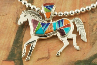 "Stunning Horse Pendant featuring Genuine Turquoise, Spiny Oyster Shell, Blue Lapis and Gaspeite inlaid in Sterling Silver. Fire and Ice Lab Opal Accents. 18"" Sterling Silver Bead Necklace is included. Designed by Navajo Artist Calvin Begay. Signed by the artist."