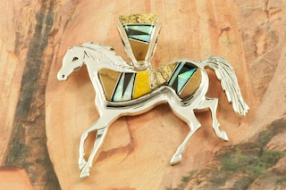 "Stunning Horse Pendant featuring Genuine Picture Jasper, Tiger's Eye and Black Jade inlaid between ribbons of Sterling Silver. Beautiful Fire and Ice Lab Opal Accents. Free 18"" Sterling Silver Chain with Purchase of Pendant. Designed by Navajo Artist Calvin Begay. Signed by the artist."