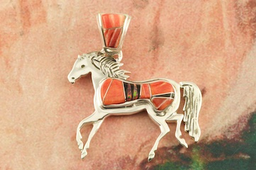 "Beautiful Horse Pendant featuring Spiny Oyster Shell and Acoma Jet inlaid between ribbons of Sterling Silver. Beautiful Fire and Ice Lab Opal Accents.  Free 18"" Sterling Silver Chain with purchase of pendant. Designed by Navajo Artist Calvin Begay. Signed by the artist."