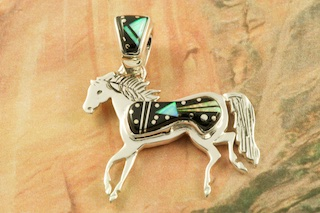 "Starry Night Design featuring Genuine Black Jade inlaid in Sterling Silver. Beautiful Fire and Ice Lab Opal Accents.  Free 18"" Sterling Silver Chain with Purchase of Pendant. Horse Pendant Designed by Navajo Artist Calvin Begay. Signed by the artist."