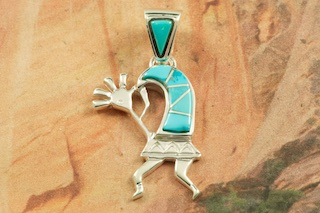 "Beautiful Kokopelli Pendant  featuring Genuine Sleeping Beauty Turquoise inlaid between ribbons of Sterling Silver.  Free 18"" Sterling Silver Chain with purchase of pendant. Designed by Navajo Artist Calvin Begay. Signed by the artist."