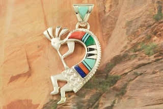 "Beautiful Kokopelli Pendant featuring Genuine Turquoise, Blue Lapis, Magnesite and Spiny Oyster Shell inlaid in Sterling Silver. Free 18"" Sterling Silver Chain with Purchase of Pendant. Designed by Navajo Artist Calvin Begay. Signed by the artist."