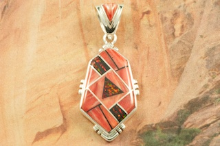 "Stunning Pendant features Genuine Spiny Oyster Shell and Black Jade inlaid between ribbons of Sterling Silver. Accented with Fire and Ice Lab Opals. Free 18"" Sterling Silver Chain with Purchase of Pendant. Created by Navajo Artist Rick Tolino. Signed by the artist."
