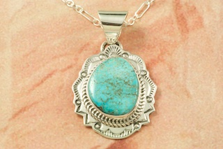 "Genuine Kingman Turquoise set in Sterling Silver Pendant. Created by Navajo Artist Joe Piaso. Signed by the artist. The Mineral Park Mine, in the Cerbat Mountains 14 miles northwest of Kingman, was first mined by Indians centuries before white man came to the area. It is one of the three sites of prehistoric mining localities in the state of Arizona. Mineral Park was the most extensively worked area by the Indians of the three. S.A. ""Chuck"" Colbaugh found a cache of stone hammers uncovered in ancient trenches and tunnels, when he had the turquoise mining concession in May of 1962. Ithaca Peak and Turquoise Mine (formally called Aztec Mountain or Aztec Peak) are the most famous of the peaks in the area containing turquoise. Free 18"" Sterling Silver Chain with purchase of pendant."
