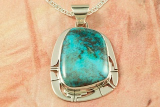 Genuine Candelaria Turquoise set in Sterling Silver Pendant. Created by Navajo Artist Phillip Sanchez. Signed by the artist. Free 18 inch Sterling Silver Chain with purchase of pendant. Candelaria Turquoise comes from the large Candelaria Silver and Gold mine in Nevada in an area not to far from Tonopah. It is currently closed with no mining activity and as such Candelaria turquoise is rare and considered a collectable. The turquoise in this area was usually found in thin veins and is known for its beautiful almost electric blue stones, sometimes with a light matrix. Over the last few years Candelaria turquoise has been seen again in today's turquoise market from older collections with beautiful dark blue stones with a beautiful matrix pattern and has now been cut and is appearing in fine jewelry. This mine produces some of the most unusual and beautiful patterns, no two stones are ever alike.