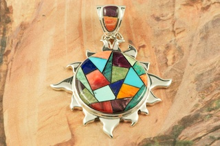 """Beautiful Sun Pendant featuring Genuine Sleeping Beauty Turquoise, Spider Web Turquoise, Spiny Oyster Shell, Black Jade and Blue Lapis inlaid in Sterling Silver. Free 18"""" Sterling Silver Chain with Purchase of Pendant. Designed by Navajo Artist Calvin Begay. Signed by the artist."""