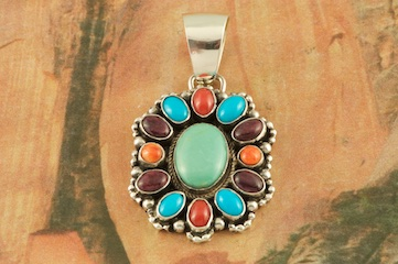 "Stunning Cluster Pendant features Genuine Sleeping Beauty Turquoise, King's Manassa Turquoise, Red Coral, Purple Spiny Oyster Shell  and Orange Spiny Oyster Shell set in Sterling Silver. Free 18"" Sterling Silver Chain with Purchase of Pendant. Created by Navajo Artist Bea Tom. Signed by the artist."