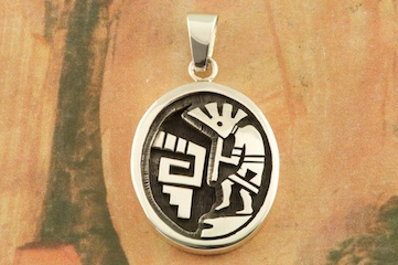 "The Sterling Silver Kokopelli Design on this Pendant is amazing. Free 18"" Sterling Silver Chain with Purchase of Pendant. Created by Navajo Artist Joe Josytewa. Signed by the artist."