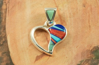 "Stunning Heart Pendant features Genuine Turquoise, Spiny Oyster Shell and Blue Lapis inlaid in Sterling Silver.  Free 18"" Sterling Silver Chain with Purchase of Pendant.  Designed by Navajo Artist Calvin Begay. Signed by the artist."