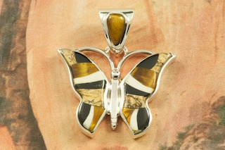 "Beautiful Butterfly Pendant featuring Genuine Picture Jasper, Tiger's Eye and Black Jade inlaid in Sterling Silver.  Free 18"" Sterling Silver Chain with purchase of pendant. Designed by Navajo Artist Calvin Begay. Signed by the artist."