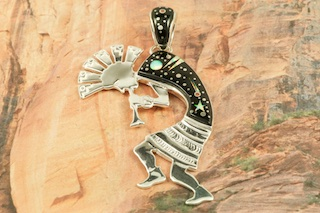"This Pendant is a work of art! Beautiful Starry Night Kokopelli Design. Featuring Picture Jasper, and Black Jade inlaid in Sterling Silver Pendant. Beautiful Fire and Ice Lab Opal, Star, Moon and Shooting Star!  Reversible Pendant with a Contemporary Sterling Silver Design. Free 18"" Sterling Silver Chain with Purchase of Pendant. Designed by Navajo Artist Calvin Begay. Signed by the artist."