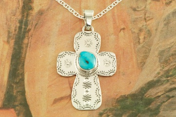 Beautiful Cross Pendant featuring Genuine Sleeping Beauty Turquoise set in Sterling Silver.  Created by Navajo Artist Burt Francisco. Signed by the artist. Free 18 inch Sterling Silver Chain with purchase of pendant. The Sleeping Beauty Turquoise Mine is located in Gila County, Arizona. The mine is recently closed and the turquoise stones are obtained from private collections.